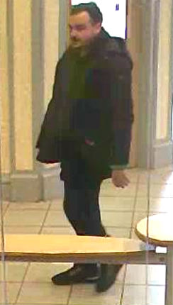 CCTV image of a man wanted by detectives in connection with the incident at Yorkshire Bank, Birkenhead on April 13.