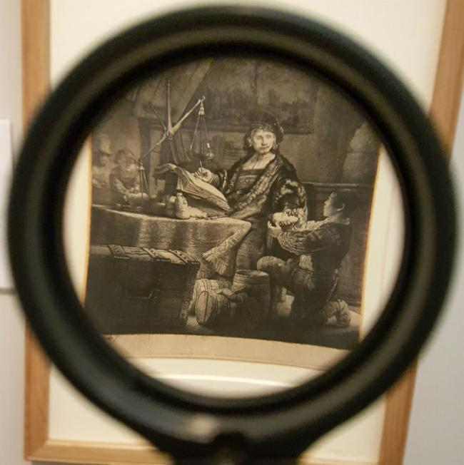 Peter Grant picked up magnifying glass to look more closely at Lady Lever's stunning new 'Rembrandt in print' exhibition