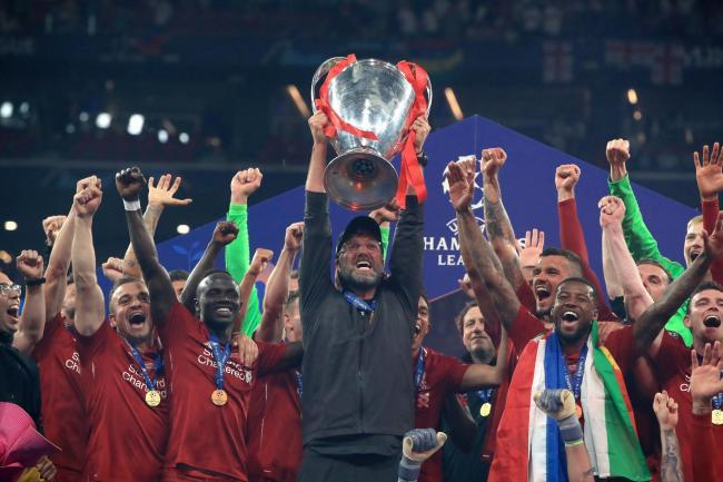 Jurgen Klopp lifts the Champions League trophy. Picture: Press Association
