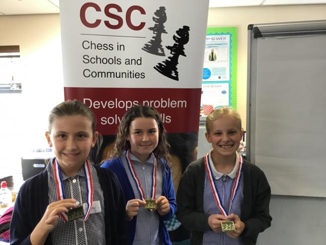 The three winners; Ava Prior (from St Bridget's Primary School), Maisie Liddicoat (from Our Lady and St Edwards R C Primary School) and Jessica-Rose Preston (from Dawpool Primary School).